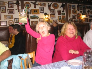 girl doing cheers at restaurant