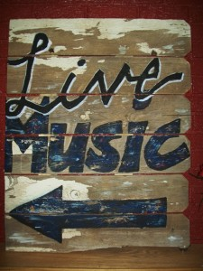 hand painted sign on wood worn and vintage feeling
