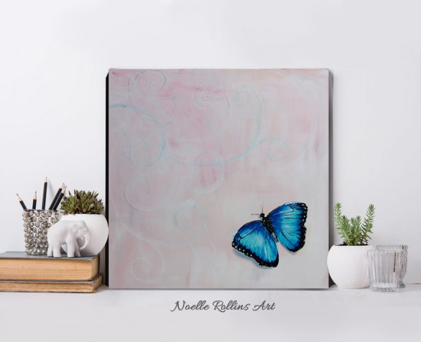 blue butterfly over pink background