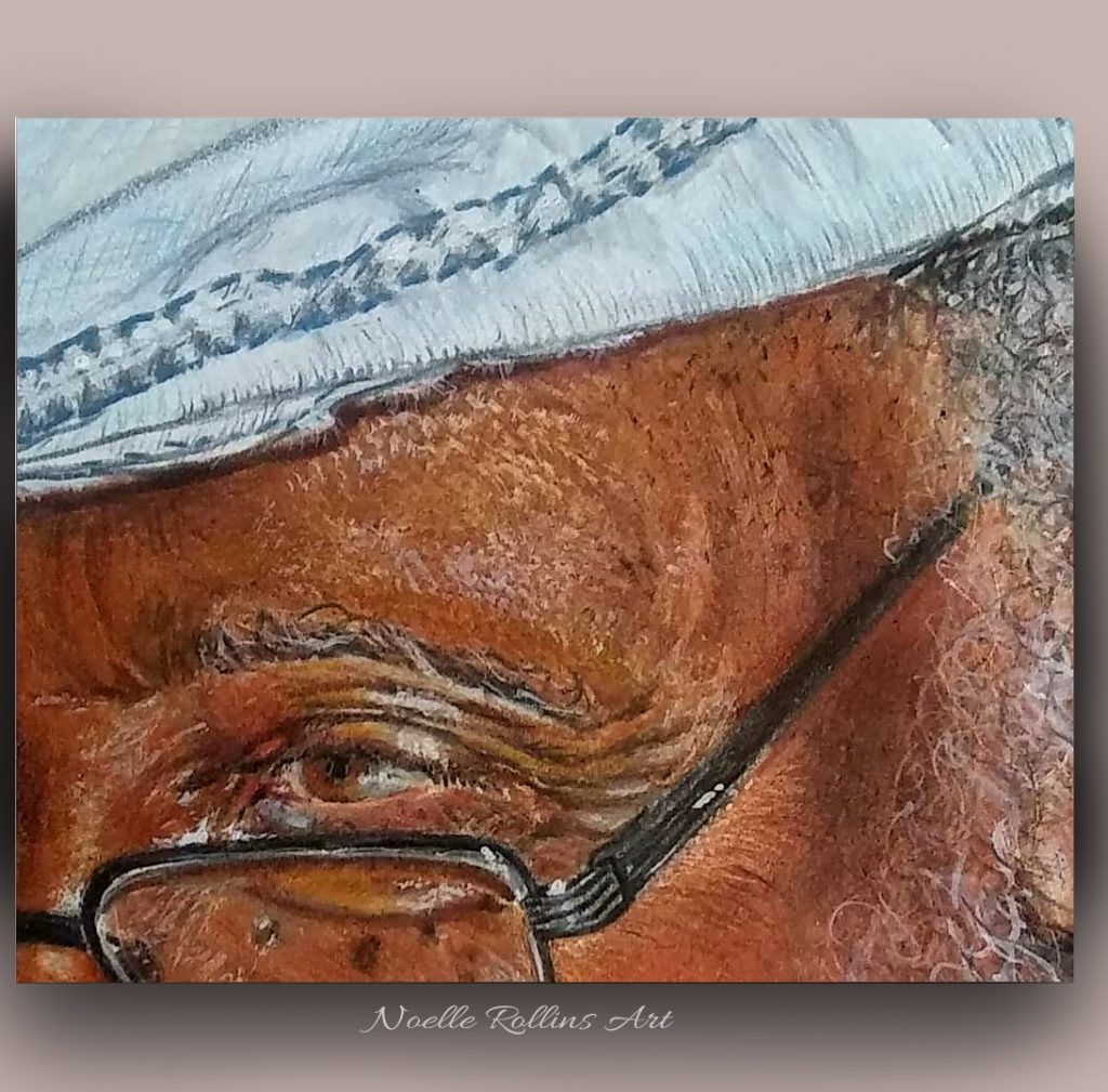 closeup of drawing of man's eye and glasses, and hat.