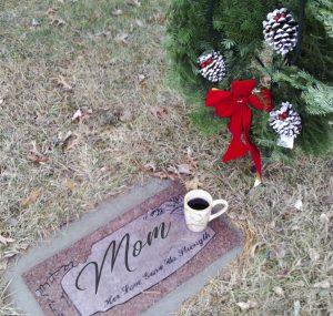 coffee mug at grave