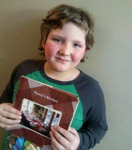 boy holding cookbook